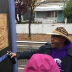 Image of artist and activist Melvin Giles discussing an art piece located on the Green Line in Saint Paul, MN.