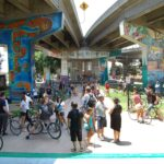 Image of Chinaco Park where you can see the murals painted underneath the highway.