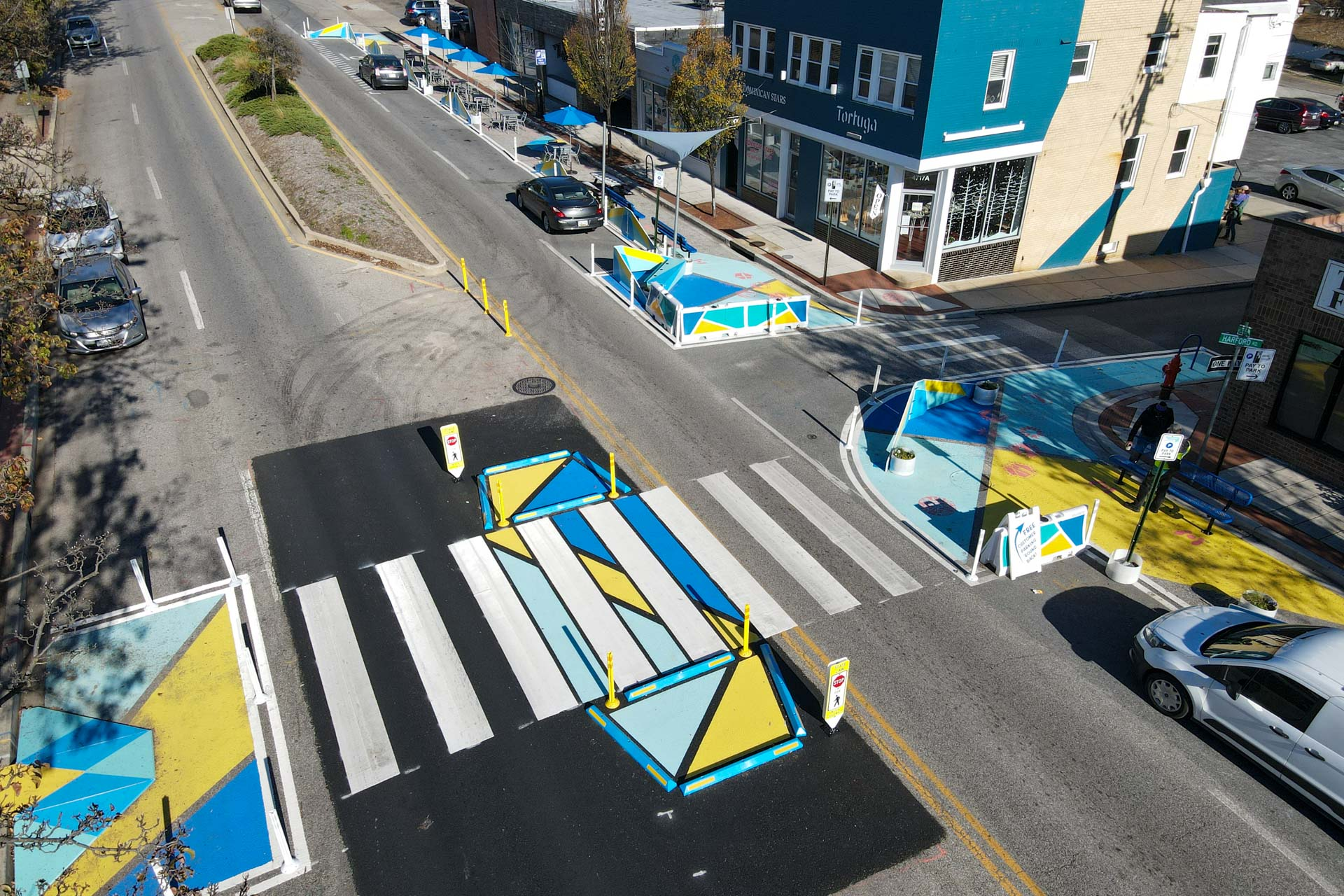 overhead view of a creatively painted crosswalk and bulb-outs and sidewalk extensions